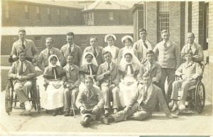 Lord Derby's War Hospital at Warrington c. 1916. Alice seated to right of man with walking stick