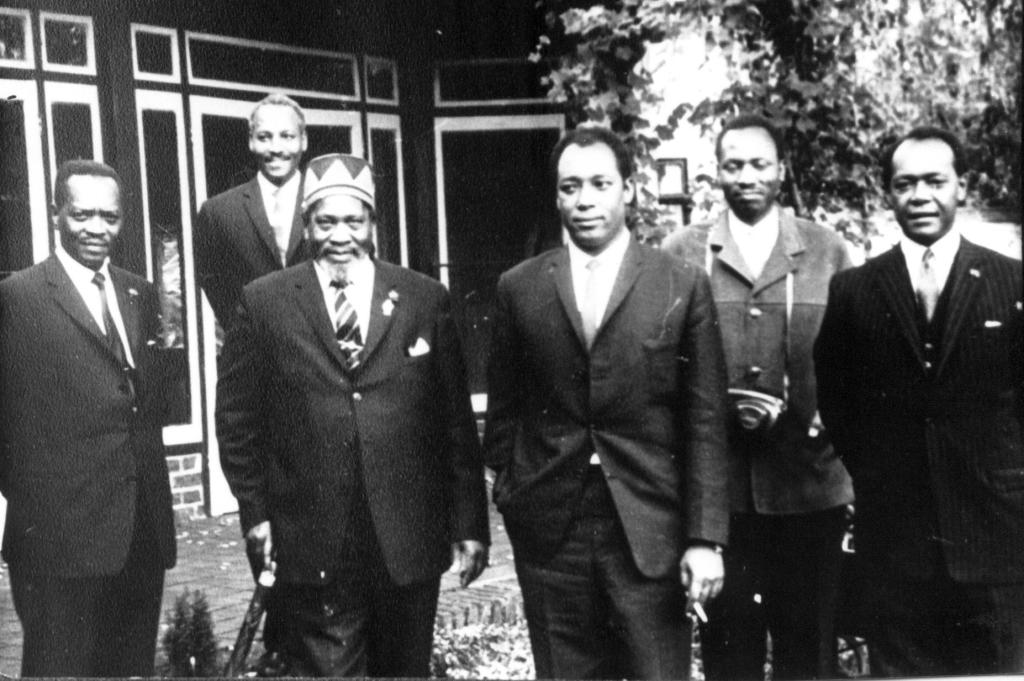 Fig. 9 Kenyatta and his entourage at his wartime home, October 1963.  L.to R. James Gichuru, defence minister; Mr Konuke, bodyguard/secretary; Jomo Kenyatta, Prime Minister; Dr. Njoroge Mungai, health minister and his personal physician; bodyguard (name unknown); Charles Njonjo, Attorney General.